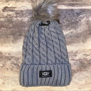 Cable stitch hat with Pom Pom.